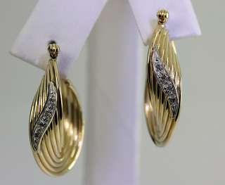 MULTIDIMENSIONAL .05CT DIAMOND 14K YELLOW GOLD TWISTED HOOP EARRINGS