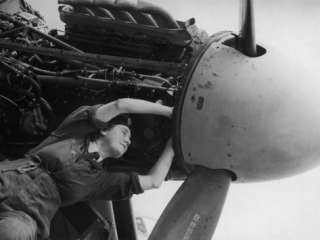 Womens Auxiliary Air Force Plane Mechanic Checking Wiring of a