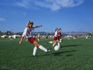 Year Old Girls in Action Durring Soccer Game, Lakewood, Colorado, USA