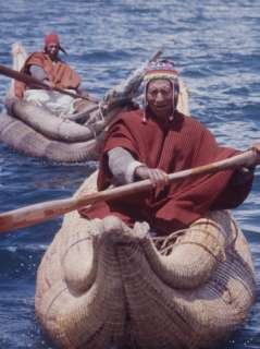 Knit Hats Row across Lake Titicaca in Totora Boats Made of Reeds, Peru