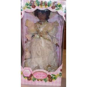 18 COLLECTIBLE PORCELAIN DOLL /BIRTHSTONE PERIDOT AUGUST